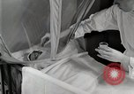 Image of baby in oxygen tent Detroit Michigan USA, 1936, second 36 stock footage video 65675023151