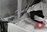 Image of baby in oxygen tent Detroit Michigan USA, 1936, second 40 stock footage video 65675023151