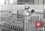 Image of baby in oxygen tent Detroit Michigan USA, 1936, second 42 stock footage video 65675023151