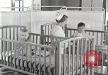 Image of baby in oxygen tent Detroit Michigan USA, 1936, second 43 stock footage video 65675023151