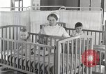 Image of baby in oxygen tent Detroit Michigan USA, 1936, second 44 stock footage video 65675023151