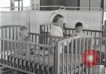 Image of baby in oxygen tent Detroit Michigan USA, 1936, second 46 stock footage video 65675023151