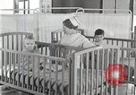 Image of baby in oxygen tent Detroit Michigan USA, 1936, second 47 stock footage video 65675023151