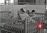 Image of baby in oxygen tent Detroit Michigan USA, 1936, second 49 stock footage video 65675023151