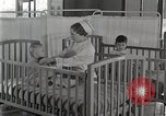 Image of baby in oxygen tent Detroit Michigan USA, 1936, second 50 stock footage video 65675023151