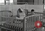 Image of baby in oxygen tent Detroit Michigan USA, 1936, second 52 stock footage video 65675023151