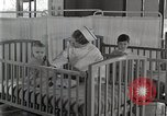 Image of baby in oxygen tent Detroit Michigan USA, 1936, second 54 stock footage video 65675023151