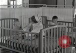 Image of baby in oxygen tent Detroit Michigan USA, 1936, second 56 stock footage video 65675023151