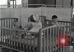 Image of baby in oxygen tent Detroit Michigan USA, 1936, second 57 stock footage video 65675023151