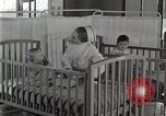Image of baby in oxygen tent Detroit Michigan USA, 1936, second 58 stock footage video 65675023151