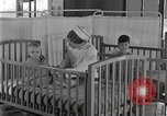 Image of baby in oxygen tent Detroit Michigan USA, 1936, second 60 stock footage video 65675023151