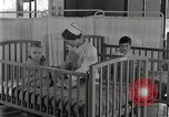 Image of baby in oxygen tent Detroit Michigan USA, 1936, second 61 stock footage video 65675023151