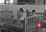 Image of baby in oxygen tent Detroit Michigan USA, 1936, second 62 stock footage video 65675023151