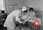 Image of child suffers from tuberculosis Detroit Michigan USA, 1936, second 3 stock footage video 65675023152