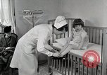 Image of child suffers from tuberculosis Detroit Michigan USA, 1936, second 4 stock footage video 65675023152