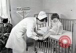 Image of child suffers from tuberculosis Detroit Michigan USA, 1936, second 5 stock footage video 65675023152