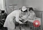 Image of child suffers from tuberculosis Detroit Michigan USA, 1936, second 6 stock footage video 65675023152