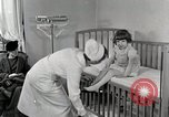 Image of child suffers from tuberculosis Detroit Michigan USA, 1936, second 7 stock footage video 65675023152