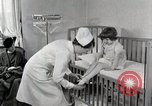 Image of child suffers from tuberculosis Detroit Michigan USA, 1936, second 8 stock footage video 65675023152
