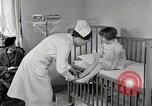Image of child suffers from tuberculosis Detroit Michigan USA, 1936, second 9 stock footage video 65675023152