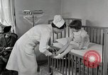 Image of child suffers from tuberculosis Detroit Michigan USA, 1936, second 11 stock footage video 65675023152