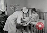 Image of child suffers from tuberculosis Detroit Michigan USA, 1936, second 12 stock footage video 65675023152