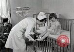 Image of child suffers from tuberculosis Detroit Michigan USA, 1936, second 14 stock footage video 65675023152