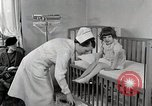Image of child suffers from tuberculosis Detroit Michigan USA, 1936, second 15 stock footage video 65675023152