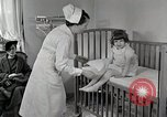 Image of child suffers from tuberculosis Detroit Michigan USA, 1936, second 17 stock footage video 65675023152