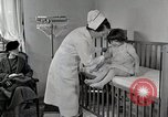 Image of child suffers from tuberculosis Detroit Michigan USA, 1936, second 18 stock footage video 65675023152