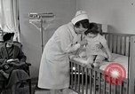 Image of child suffers from tuberculosis Detroit Michigan USA, 1936, second 20 stock footage video 65675023152