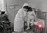 Image of child suffers from tuberculosis Detroit Michigan USA, 1936, second 21 stock footage video 65675023152