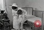Image of child suffers from tuberculosis Detroit Michigan USA, 1936, second 22 stock footage video 65675023152