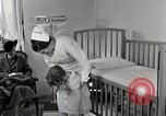 Image of child suffers from tuberculosis Detroit Michigan USA, 1936, second 23 stock footage video 65675023152