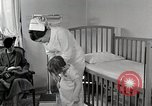 Image of child suffers from tuberculosis Detroit Michigan USA, 1936, second 24 stock footage video 65675023152