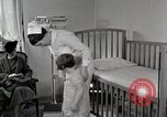 Image of child suffers from tuberculosis Detroit Michigan USA, 1936, second 25 stock footage video 65675023152