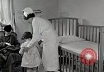 Image of child suffers from tuberculosis Detroit Michigan USA, 1936, second 26 stock footage video 65675023152