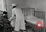 Image of child suffers from tuberculosis Detroit Michigan USA, 1936, second 27 stock footage video 65675023152