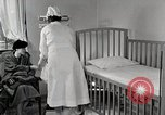 Image of child suffers from tuberculosis Detroit Michigan USA, 1936, second 28 stock footage video 65675023152