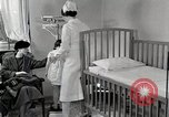 Image of child suffers from tuberculosis Detroit Michigan USA, 1936, second 29 stock footage video 65675023152