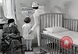 Image of child suffers from tuberculosis Detroit Michigan USA, 1936, second 32 stock footage video 65675023152