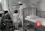 Image of child suffers from tuberculosis Detroit Michigan USA, 1936, second 33 stock footage video 65675023152