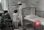 Image of child suffers from tuberculosis Detroit Michigan USA, 1936, second 35 stock footage video 65675023152