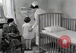 Image of child suffers from tuberculosis Detroit Michigan USA, 1936, second 37 stock footage video 65675023152