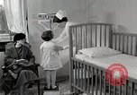 Image of child suffers from tuberculosis Detroit Michigan USA, 1936, second 38 stock footage video 65675023152