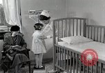 Image of child suffers from tuberculosis Detroit Michigan USA, 1936, second 39 stock footage video 65675023152