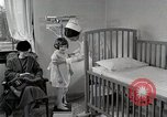Image of child suffers from tuberculosis Detroit Michigan USA, 1936, second 40 stock footage video 65675023152
