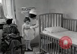 Image of child suffers from tuberculosis Detroit Michigan USA, 1936, second 41 stock footage video 65675023152