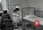 Image of child suffers from tuberculosis Detroit Michigan USA, 1936, second 42 stock footage video 65675023152