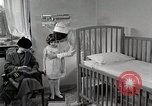 Image of child suffers from tuberculosis Detroit Michigan USA, 1936, second 43 stock footage video 65675023152